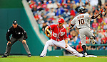 1 May 2011: Washington Nationals first baseman Adam LaRoche makes a play at first, but Miguel Tejada is safe by a step during a game against the San Francisco Giants at Nationals Park in Washington, District of Columbia. The Nationals defeated the Giants 5-2. Mandatory Credit: Ed Wolfstein Photo