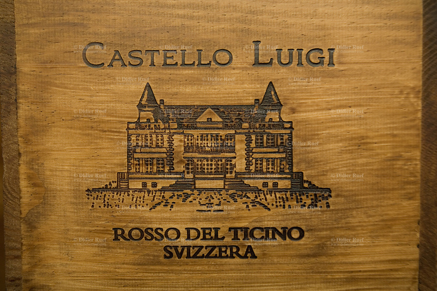 "Switzerland. Canton Ticino. Besazio. ""Castello Luigi"". Wood boxes of Merlot red wine by Luigi Zanini, wine grower and producer.  © 2008 Didier Ruef"