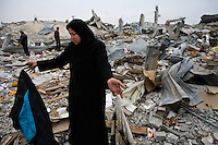 Jabalya, Gaza Strip, Jan 23 2009..Sadia Raba Hassan, 50, walks through what's left of her home and large family import-export business..Stunned inhabitants of Jabalya return to where their homes, farms and factories used to stand, only to find a huge rubble field, levelled by Israeli bombs, explosives and bulldozers. Not a wall is standing over a very large area on the eastern side of the village facing the israeli border..