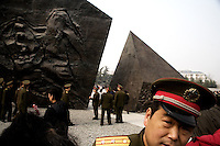"A soldier walks among the sculptures in the Assembly Ground outside the Memorial Hall of the Nanjing Massacre in Nanjing, China, on Thursday, Dec. 13, 2007.  After two years of renovations, the Memorial Hall of the Nanjing Massacre reopened to the public on Dec. 13, 2007, the 70th anniversary of the 6-week massacre by Japanese troops that started Dec. 13, 1937 and claimed more than 300,000 lives.  The commemoration comes amid renewed controversy about the accuracy of historical accounts of the massacre.  The massacre is also known as ""The Rape of Nanking."""