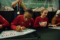 DENVER, CO--Alex Green signs posters during a fan autograph session at the Pepsi Center for the 2012 NCAA Women's Final Four festivities in Denver, CO.