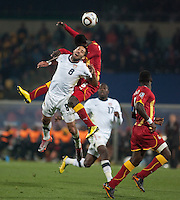 USA's Clint Dempsey fights for a header with Ghana's Jonathan Mensah  in the second half of the 2010 second round World Cup match between USA and Ghana in Rustenberg, South Africa on Saturday, June 26, 2010.