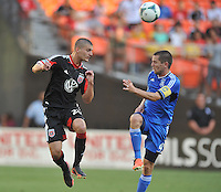 Perry Kitchen (23) of D.C. United heads the ball against Sam Cronin (4) of the San Jose Earthquakes.  D.C. United defeated the San Jose Earthquakes 1-0, at RFK Stadium, Saturday June 22 , 2013.