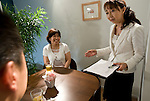 """Etsuko Satake (r) critiques a simulation class between student """"Keiko"""" (c) and an unidentified coach (l) at Infini, a school training marriage hopefuls how to hook Mr. or Mrs. Right in Tokyo, Japan on Sep. 9, 2010."""