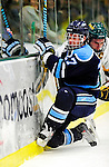 30 January 2010: University of Maine Black Bears' defenseman Will O'Neill, a Sophomore from Salem, MA, is checks into the boards by Brian Roloff of the University of Vermont Catamounts at Gutterson Fieldhouse in Burlington, Vermont. The Black Bears and the Catamounts played to a 4-4 tie in the second game of their America East weekend series. Mandatory Credit: Ed Wolfstein Photo