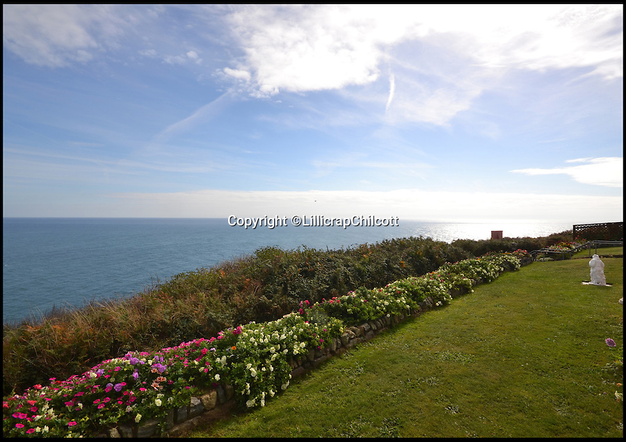 BNPS.co.uk (01202 558833)<br /> Pic: LillicrapChilcott/BNPS<br /> <br /> The house's view over the sea.<br /> <br /> Next stop Spain!<br /> <br /> A rare chance to own the most southerly house in Britain nestled on a rocky outcrop overlooking the English Channel has arisen - but prospective buyers will have to rustle up &pound;575,000 to get their hands on it.<br /> <br /> The secluded two-bed terraced house would be ideal for those looking to be at one with nature - because it sits on the tip of Bass Point at The Lizard in Cornwall, the most southerly part of mainland Britain.<br /> <br /> Once a coastguard cottage, it offers sweeping 180 degree views of the rugged coastline and is so exposed to the elements its owners say sitting in the lounge feels like being out at sea.<br /> <br /> If you were to travel due south of the house the next land you would hit would be Santander in Spain.