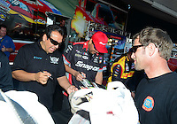 Sept. 29, 2012; Madison, IL, USA: NHRA funny car driver Tony pedregon (left) with Cruz Pedregon during qualifying for the Midwest Nationals at Gateway Motorsports Park. Mandatory Credit: Mark J. Rebilas-