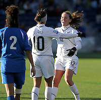 US midfielder Carli Lloyd (10) gets a hug from forward Lauren Cheney (12) after the victory.  The U.S. Women's National Team defeated Italy 1-0 at Toyota Park in Bridgeview, IL on November 27, 2010 to advance to the Women's World Cup in Germany.