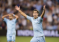 Graham Zusi (8) of Sporting Kansas City reacts to a missed attempt on goal during the game at Livestrong Sporting Park in Kansas City, Kansas.  D.C. United lost to Sporting Kansas City, 1-0.