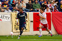 Sherjill MacDonald (7) of the Chicago Fire is chased by Heath Pearce (3) of the New York Red Bulls. The Chicago Fire defeated the New York Red Bulls 2-0 during a Major League Soccer (MLS) match at Red Bull Arena in Harrison, NJ, on October 06, 2012.