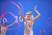 Anzhelika Savrayuk of rhythmic group of Italy performs with ribbon+rope on way to winning Event Finals gold at 2010 Pesaro World Cup on August 29, 2010 at Pesaro, Italy.  Photo by Tom Theobald.