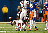 Louisville running back Jeremy Wright reacts to the referee after losing a helmet during 79th Sugar Bowl game against Florida at Mercedes-Benz Superdome in New Orleans, Louisiana on January 2nd, 2013.   Louisville Cardinals defeated Florida Gators, 33-23.