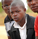 YOUNG MEN IN THE VILLAGE OF KUNENEKUDE, MWANZA, MALAWI, ALL HIV NEGATIVE, DESCRIBE HOW THEIR BEHAVIOUR HAS CHANGED SINCE THE GOOD SAMARITAN PROJECT. PATRICK ALKAHEAS, 19. PICTURE BY CLARE KENDALL. 3/11/12