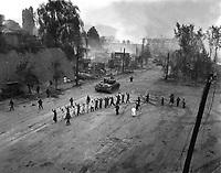 A U.S. Marine tank follows a line of prisoners of war down a village street.  September 26, 1950.  S. Sgt. John Babyak, Jr.  (Marine Corps)<br /> NARA FILE #:  127-N-A3810<br /> WAR &amp; CONFLICT BOOK #:  1488