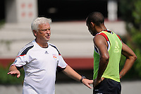 New York Red Bulls head coach Hans Backe talks with Thierry Henry (14) at the end of a New York Red Bulls practice on the campus of Montclair State University in Upper Montclair, NJ, on July 16, 2010.