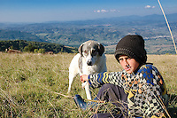 A shepherd boy and his dog in the hills of Maramures.