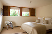 One of the light and airy bedrooms which all have views of trees and the sea