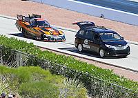 Apr 12, 2015; Las Vegas, NV, USA; The Toyota tow vehicle tows NHRA funny car driver Alexis DeJoria during the Summitracing.com Nationals at The Strip at Las Vegas Motor Speedway. Mandatory Credit: Mark J. Rebilas-
