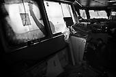 Szczecin 13 February 2009 Poland.<br /> The Szczecin Shipyard<br /> The Polish shipyard industry is in a deep crisis. The Gdansk and Szczecin shipyards are under the threat of liquidation. The battle between the Polish government, creditors and European Union rages on. Shipyard workers live under intense pressure of dissmissals. They are completely unsure of their future; they leave, search for work in England, Irland, Norway. During last two months over 25 % of workers left the Szczecin shipyard. The trade union Solidarnosc, with its cradle shipyard in Gdansk fought for free Poland 27 years ago. Today it fights for the survival of the shipyard.It organizes manifestations and pickets. In the 70's and 80's nearly 20 thousand people worked in the shipyard. Today only 3 thousand are left and a ghost feeling of emptiness in most of the shipyard's sectors.<br /> ( &copy; Filip Cwik / Napo Images for Newsweek Poland )<br /> <br /> Szczecin 13 luty 2009 Polska.<br /> Polski przemysl stoczniowy pograzony jest w glebokim kryzysie. Stoczniom z Gdanska i Szczecina grozi likwidacja. Gra sie toczy pomiedzy Polskim rzadem, wierzycielami a Unia Europejska. Stoczniowcom groza zwolnienia grupowe. Nie sa pewni przyszlosci; odchodza, wyjezdzaja do Anglii, Irlandii, Norwegii. W ciagu dwoch miesiecy ze stoczni Szczecinskiej zwolnilo sie 25% pracownikow. Zwiazek zawodowy Solidarnosc, ktorej kolebka jest zaklad w Gdansku 27 lat temu walczyl o wolna Polske, dzis walczy o utrzymanie zakladu pracy. Organizuje protesty manifestacje i pikiety.<br /> ( &copy; Filip Cwik / Napo Images dla Newsweek Polska )