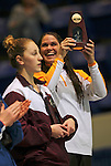 24 MAR 2012:  Christie Raleigh of Rowan University holds up the first place trophy for the 100 yard freestyle event during the Division III Mens and Womens Swimming and Diving Championship held at the IU Natatorium in Indianapolis, IN.  Raleigh won the event with a time of 49.94. Michael Hickey/NCAA Photos