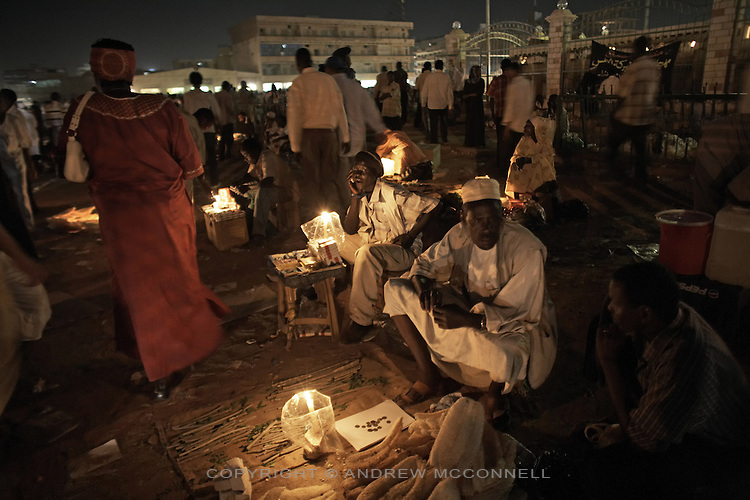 Vendors sell their wares at Souq Al-Arabi in central Khartoum, Sudan. Khartoum is modeling itself as the Dubai of Africa and despite Western sanctions the city is booming. Away from the troubles and poverty that plaque the rest of Sudan, development in Khartoum is moving at an astonishing rate. Investment from the East, and in particular China, allowed the Sudanese economy to grow by 11% in 2007. This growth is driven largely by oil, with production rising from 63,000 barrels per day in 1999 to over 500,000 barrels today.