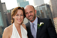 Closeup portrait of bride and groom.