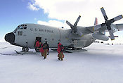 Passengers board an LC-130, a ski-equipped cargo plane at McMurdo Station, Antarctica. The plane is bound for the South Pole. Ernie Mastroianni photo