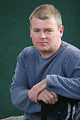 MARK HADDON, AUTHOR OF WORLD BESTSELLER 'THE CURIOUS INCIDENT OF THE DOG IN THE NIGHT' , AND 'A SPOT OF BOTHER'. WINNER OF 17 LITERARY AWARDS. EDINBURGH INTERNATIONAL BOOK FESTIVAL. Wednesday 23th August 2006. The musicians were appearing to talk with youngsters about the art of song writing. Over 600 authors from 35 countries are appearing at the Edinburgh International Book festival during 12th-28th August. The festival takes place in historic Edinburgh city, a UNESCO City of Literature.