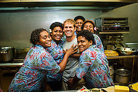 Tavarua Island, Fiji. The Fijian workers on the island are always smiling. The kitchen staff with pro surfer Damien Hobgood (USA). Photo: joliphotos.com