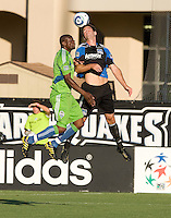 Bobby Burling of Earthquakes fights for the ball in the air against Blaise Nkufo of Sounders during the game at Buck Shaw Stadium in Santa Clara, California on July 31st, 2010.   Seattle Sounders defeated San Jose Earthquakes, 1-0.