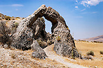 Chinaman's Arch in the Golden Spike National Historic Site in Utah is a natural memorial to the Chinese laborers who worked on the construction of the Central Pacific Railroad. The arch, consisting of Lake Bonnevile Limestone, was naturally formed through water erosion. The arch is located near Promontory Summit where the driving of the Golden Spike occured on May 10, 1969, marking the completion of the Transcontinental Railroad and is accessible by hiking or auto tour. Photographed 07/07