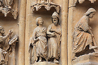 The prophet Hosea marrying Gomer, daughter of Diblaim, on one of the left-hand archivolts of the tympanum of the South portal or St Honore portal on the South transept of the Basilique Cathedrale Notre-Dame d'Amiens or Cathedral Basilica of Our Lady of Amiens, built 1220-70 in Gothic style, Amiens, Picardy, France. St Honore or Honoratus was the 7th bishop of Amiens who lived in the 6th century AD. Amiens Cathedral was listed as a UNESCO World Heritage Site in 1981. Picture by Manuel Cohen