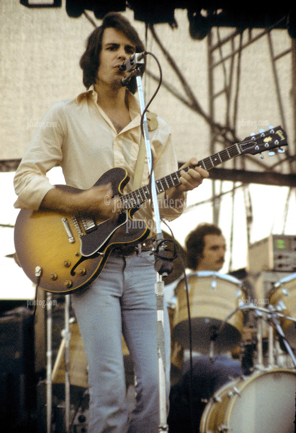 Bob Weir performing with The Grateful Dead Live at Dillon Stadium, Hartford, CT 31 July 1974. Featuring the Wall of Sound. Singing and strumming with Billy in the background drumming.