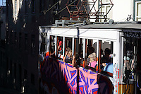 Tourists crowding in the graffiti-covered Gloria Funicular or Ascensor da Gloria or Elevador da Gloria, inaugurated in 1885, leading up the Calcada da Gloria to the Miradouro Sao Pedro de Alcantara, linking downtown with the Barrio Alto, Lisbon, Portugal. The tram is listed as a National Monument. Picture by Manuel Cohen