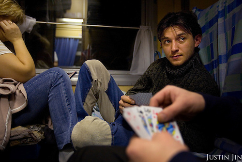 Russian passengers play cards on a night train across Russia. The train, beginning in Berlin, Germany, goes through Poland and Belarus, and ends in Irkutsk, Russia. The entire journey takes six days.
