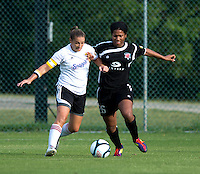 Victoria Johnson (26) of the Virginia Beach Piranhas fights for the ball with Missy Wycinsky (2) of the Fredericksburg Impact during the game at the University of Mary Washington Battleground Stadium in Fredericksburg, VA.   The Virginia Beach Piranhas defeated the Fredericksburg Impact, 2-0, in a weather shortened game.