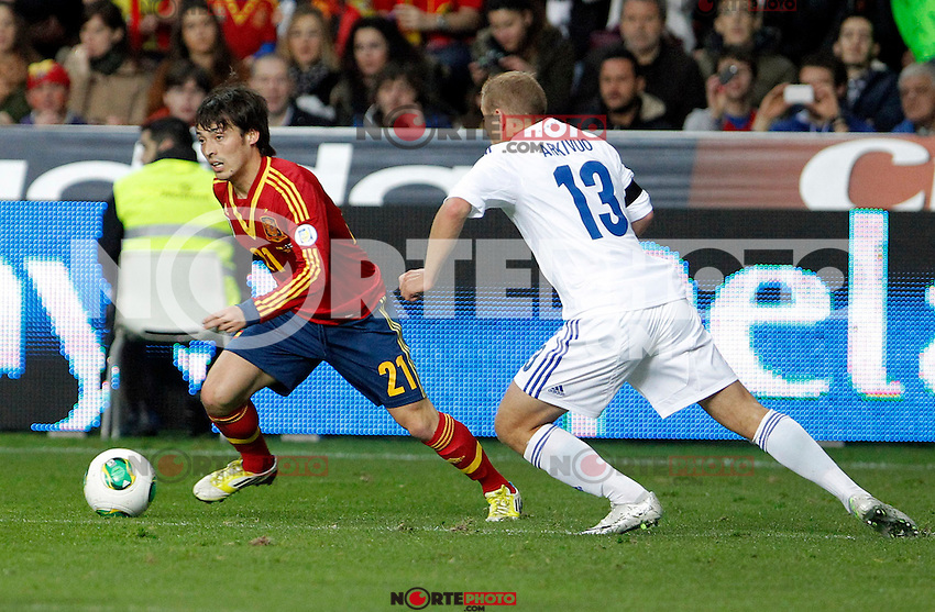 Spain's David Jimenez Silva and Finland's Arkivuo during international match of the qualifiers for the FIFA World Cup Brazil 2014.March 22,2013.(ALTERPHOTOS/Victor Blanco)