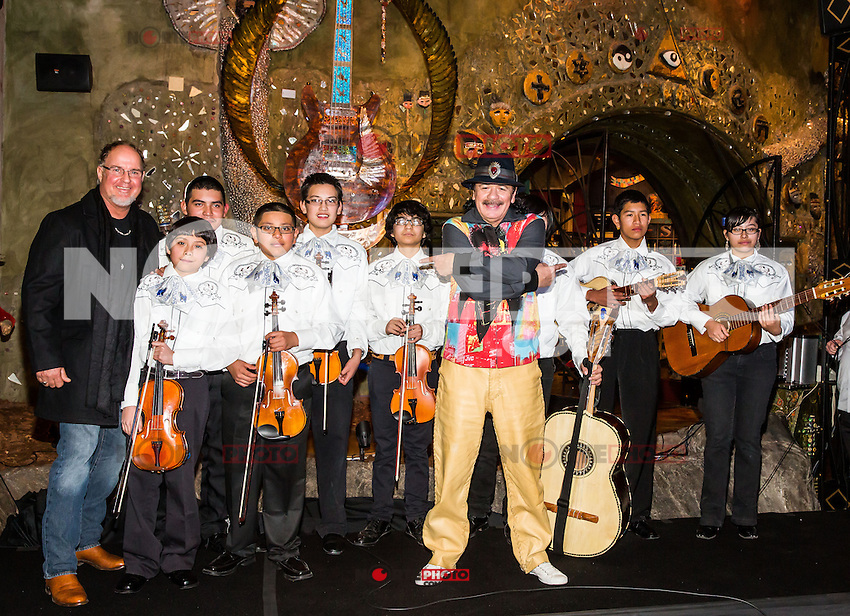 LAS VEGAS, NV - January 16 : Dale Evers, Carlos Santana and Clark Country School District Mariachi Band pictured as House of Blues Las Vegas unveils 13-foot high guitar sculpture ?Wings of Legend? that will commemorate the return of Carlos Santana's residency: An Intimate Evening with Santana: Greatest Hits Live - Yesterday, Today & Tomorrow and continue the 20th Anniversary celebration of the House of Blues brand at House of Blues at Mandalay Bay in Las Vegas, Nevada on January 16, 2013. Credit: Kabik/Starlitepics/MediaPunch Inc. ***HOUSE COVERAGE*** /NortePhoto