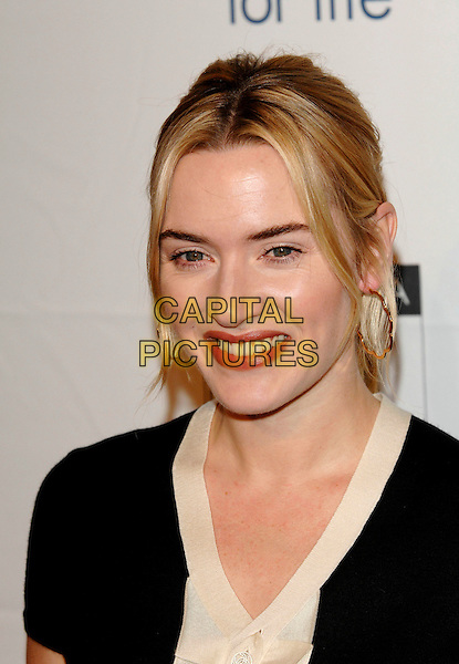 KATE WINSLET.Arrivals at BAFTA Tea Party at Four Seasons Hotel.Beveley Hills, California USA.14th January 2007.portrait headshot gold hoop earrings .CAP/PL.©Phil Loftus/Capital Pictures