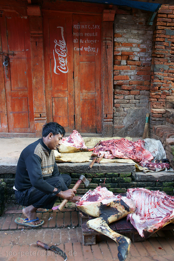 butcher cutting a buffalo, sacrificed during dashain festival time in Bhaktapur, Nepal. October 2011