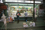 "April 27, 1990, Rome, Italy. Photographing for the book ""One day in the life of Italy"", this is an exploration of Rome. Around 4am to 5am, at Lungotevere,  a very busy meat, fish and vegetable market is shown. Shops in Mercati Generali VIa Ostiense."
