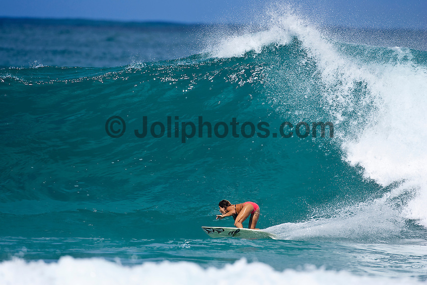 Clare Bevilacqua (AUS) surfing Gums on the  North Shore, Haleiwa, Oahu, Hawaii..Photo: Joliphotos.com