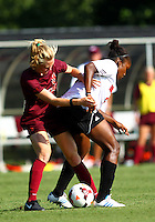 WINSTON-SALEM, NORTH CAROLINA - August 30, 2013:<br />  Christine Exeter (22) of Louisville University battles for the ball with Kelsey Loupee (9) of Virginia Tech during a match at the Wake Forest Invitational tournament at Wake Forest University on August 30. The game ended in a 1-1 tie.