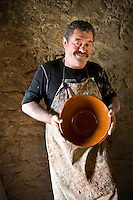 "Portrait of a French potter from the Not family who makes the traditional clay pots or ""cassoles"" in which cassoulet is cooked"