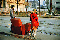ROMANIA, Bucharest, Turda street, October 1978..The red armchair takes the tram.ROUMANIE, Bucarest, rue Turda, octobre 1978..La fauteuil rouge prend le tram..© Andrei Pandele / EST&OST