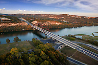 High Angle helicopter, birds eye view of the Pennybacker 360 Bridge in the Texas Hill Country surrounding Austin, Texas