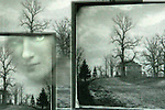 Conceptual image of female face appearing through frame in countryside