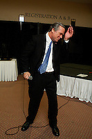 George W. Bush and impersonator sings karaoke on stage at a celebrity impersonators convention in America
