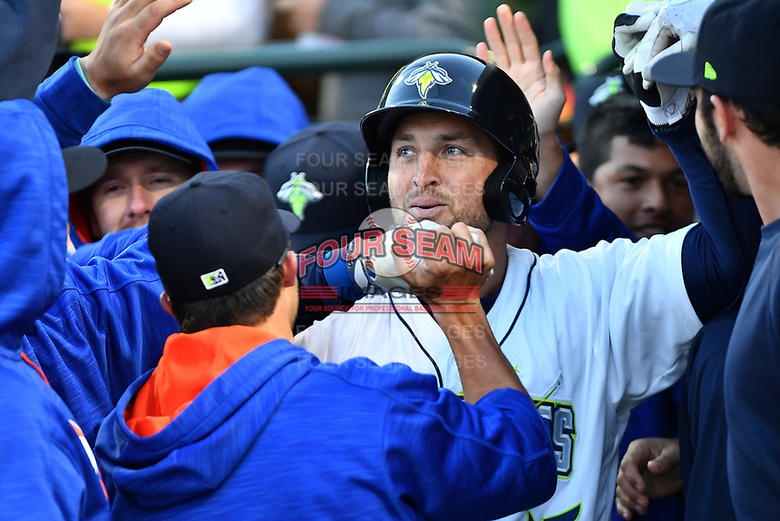 Left fielder Tim Tebow (15) of the Columbia Fireflies is congratulated in the dugout after hitting a home run in his first Class A at bat in a game against the Augusta GreenJackets on Opening Day, Thursday, April 6, 2017, at Spirit Communications Park in Columbia, South Carolina. (Tom Priddy/Four Seam Images)