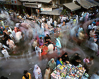Street vendors and shopping crowds at a market in a Muslim quarter of the city centre near Mohammed Ali Road.
